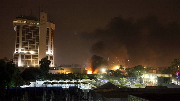 Twin car bombs at top Baghdad hotels kill 10, wound 30
