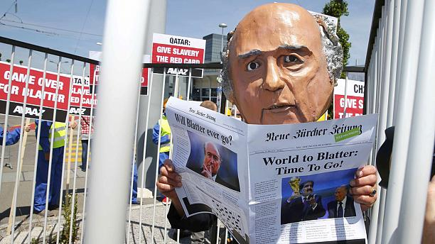 Protesters demand the resignation of FIFA's Blatter