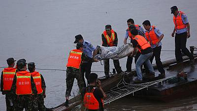 Relatives wait anxious for news after China ferry capsizes