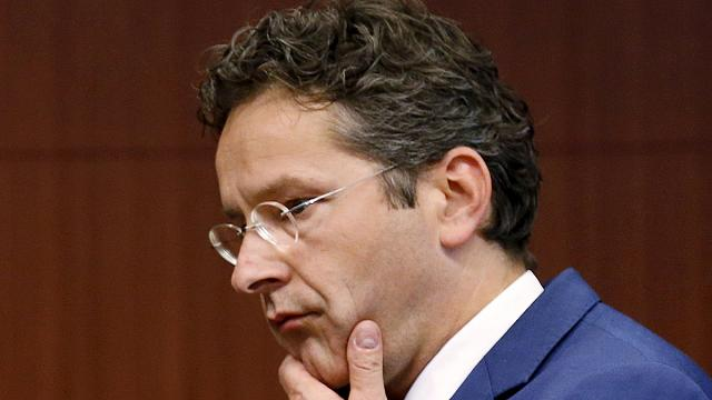 Eurogroup head dampens Greece's enthusiasm over debt deal