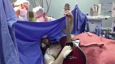 Watch: Brave Beatles fan plays guitar during brain surgery