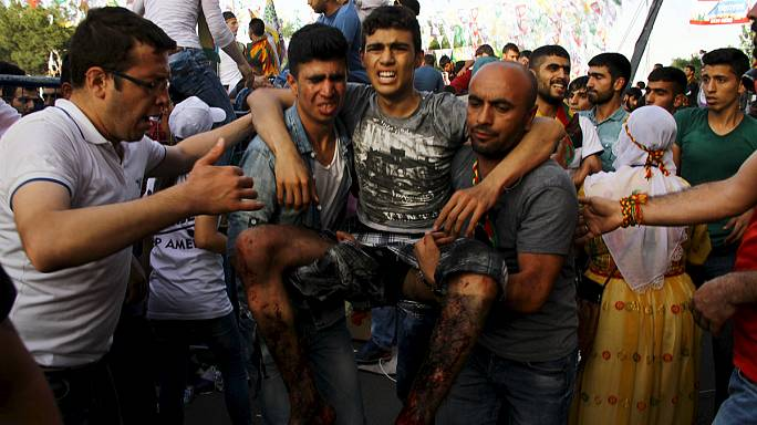 Explosions kill 2, injure 100 at Kurdish rally in eastern Turkey
