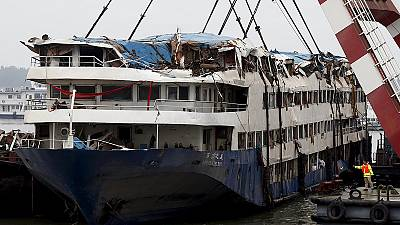 Volunteers help identify victims of Chinese cruise ship disaster