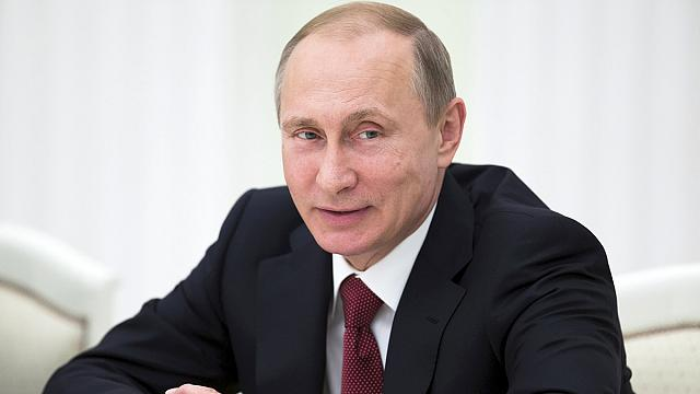 Absent from G7, Putin says Russia 'no threat' to West