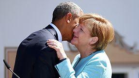 Obama and Merkel cheers