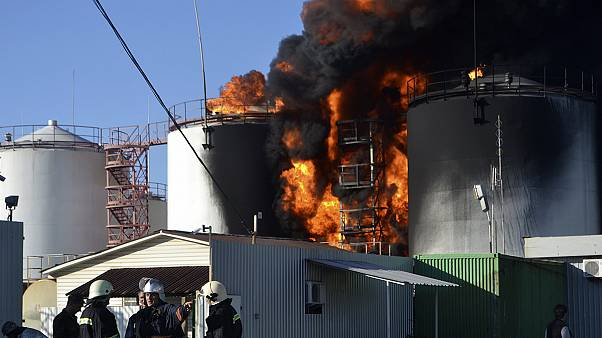 A huge fire rages out of control at a fuel depot in Ukraine