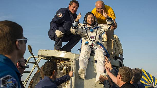 Space trio lands safely after 199 days in orbit