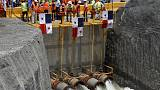 Engineers flood newly-expanded Panama Canal section