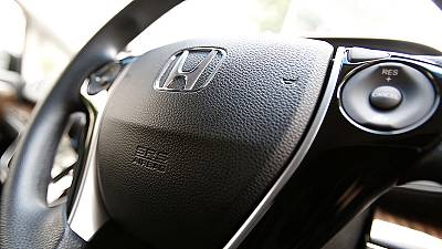 Honda maintains dividend, profits, despite worsening airbag woes