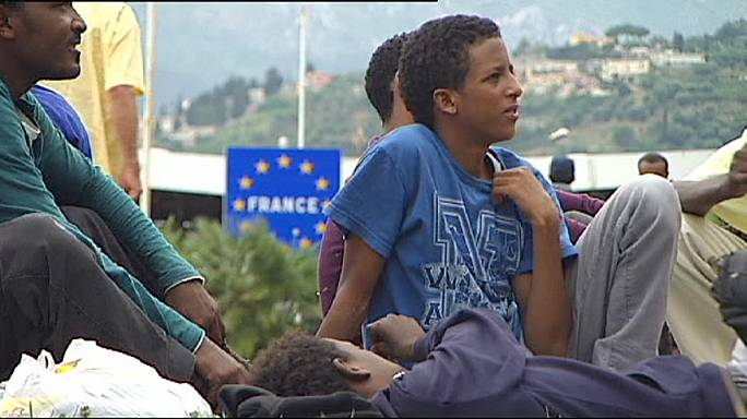 French police block African immigrants trying to cross the border from Italy