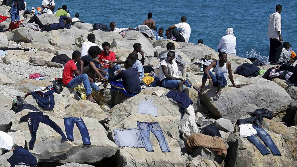 Migrants refuse to go away as French police prevent them crossing the Italian frontier