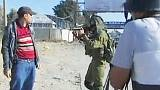 Video shows Israeli soldiers beating unarmed Palestinian demonstrator