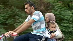 Migrants cross FYROM by bike on way to EU