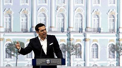 Tsipras courts Putin as pressure mounts on Greece