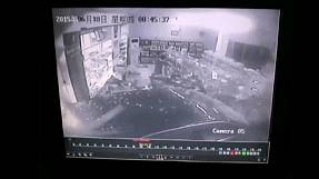 China: dizzy driver crashes car into a pharmacy