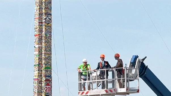 Scaling new Lego heights: children build world's tallest tower in Milan