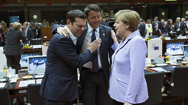 EU leaders agree migrant plan, while Greek debt deal remains elusive