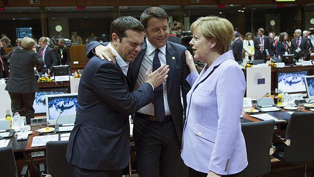 EU leaders agree migrant plan, while Greek debt deal remains elusive