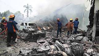 Dozens killed as Indonesian military plane crashes on houses in Sumatra
