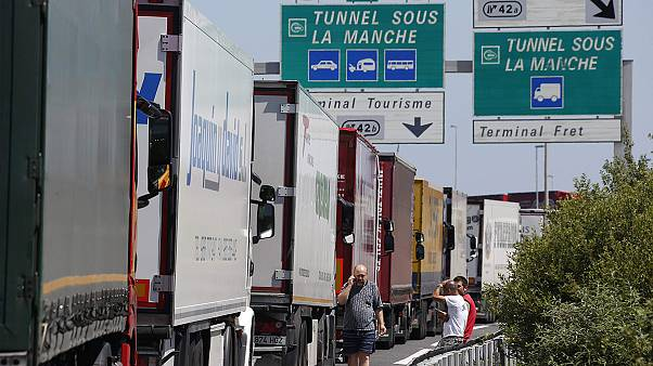 Channel tunnel closed again as ferry workers protest on rails