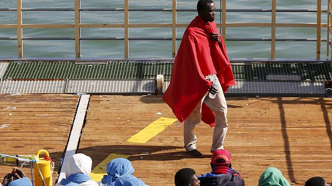 Status approved, but nowhere to go: refugees form makeshift camp in Italy