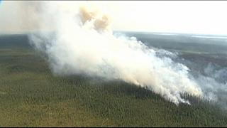 Canada wildfires force evacuation of entire communities