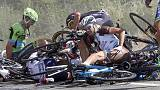 Horror crash mars Tour de France as Britain's Froome earns leader's yellow jersey