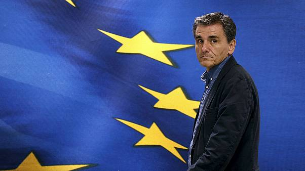 Euclid Tsakalotos sworn in as new Greek finance minister
