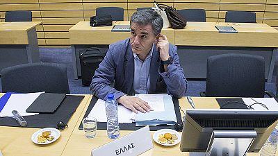 Tsakalotos reveals notes but no new proposals at Eurogroup
