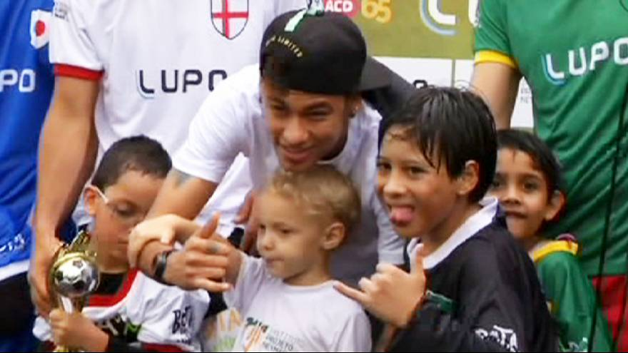 Brazil star Neymar helps disabled kids play football for the first time