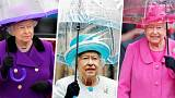 Queen Elizabeth II with umbrellas