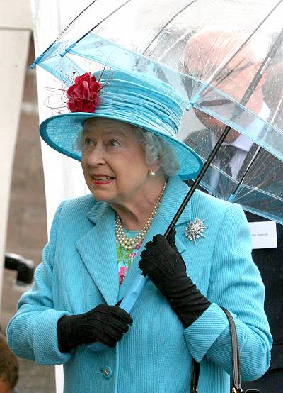 The Queen is bright in blue, even when the skies are dark and gray (or, as they\'d say in Britain, *grey*).