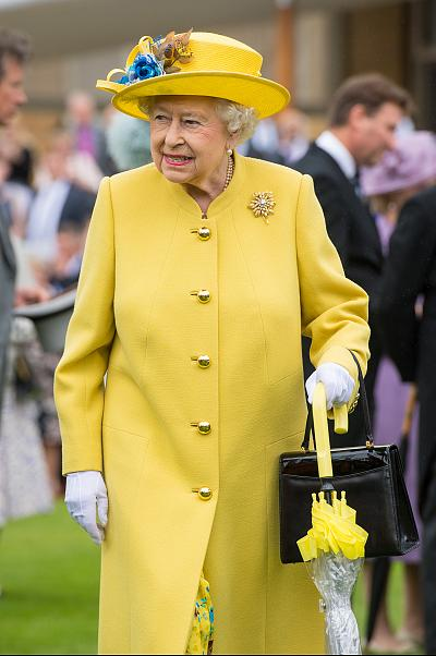 She\'s got sunshine on a cloudy day in May, when attendants at her garden party observed a moment of silence for victims of the 2017 Manchester terror attacks.