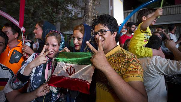 Iranians celebrate a future with no sanctions after nuclear deal