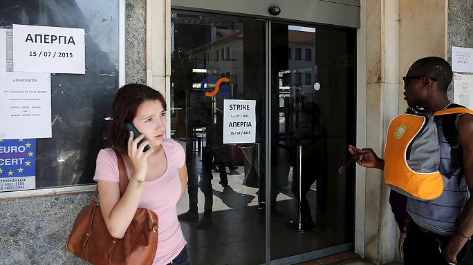 Workers walk out in Greece in protest over austerity measures before parliament