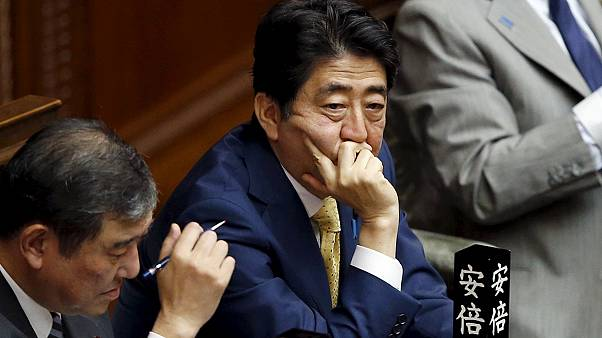 Japan lawmakers approve contentious bills to bolster military presence abroad