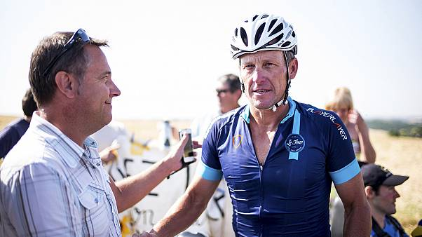 Armstrong returns to the Tour de France for charity