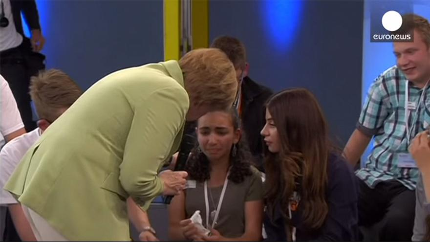 #Merkelstrokes: the German Chancellor is confronted by a crying refugee