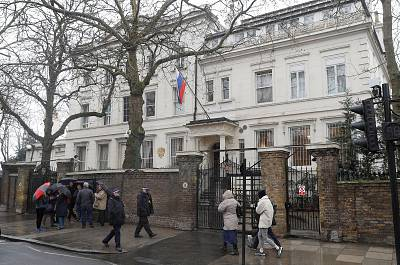 Police officers walk past the Russian embassy in London, .