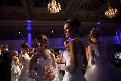 Young Russian debutantes assemble in Old Billingsgate Hall before their first performance in the The Russian Ball in London.