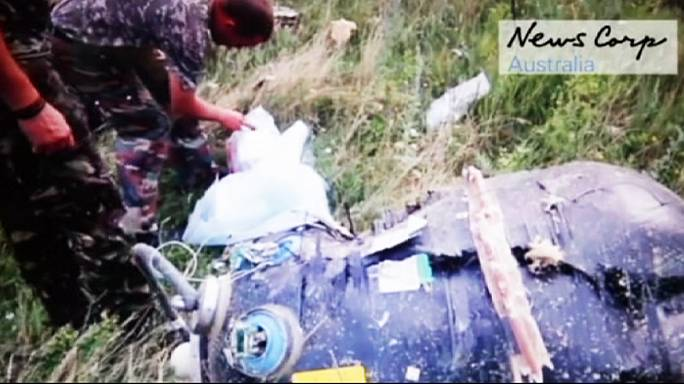 MH17 new footage: rebels discover debris is from a civilian aircraft