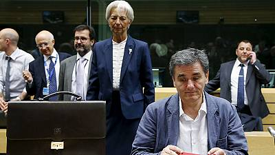 EU finalises 7 bln euro bridge loan for Greece, says debt 'restructuring' back on table