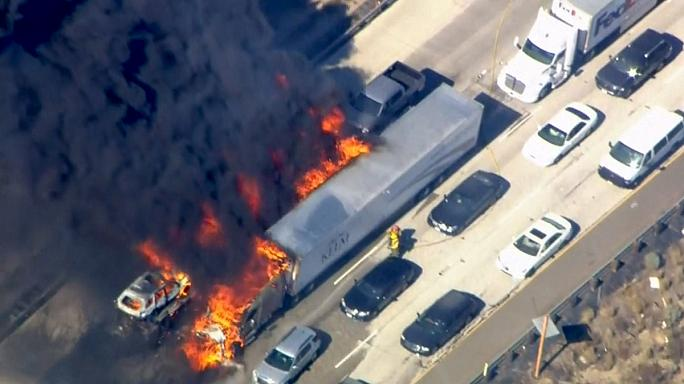 Drivers flee as wildfire engulfs southern California highway