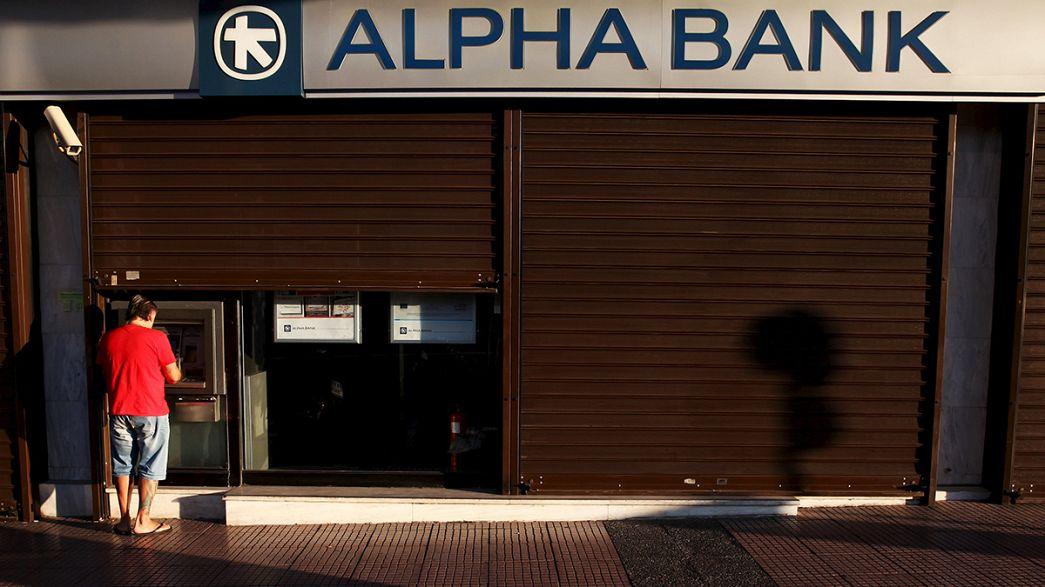 Grecia, riaprono le banche: prelievi limitati a 420 euro la settimana