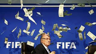 FIFA chief Blatter showered in fake bank-notes by prankster