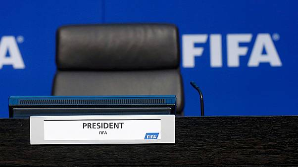 Sepp Blatter suspends press conference after being showered with fake dollars