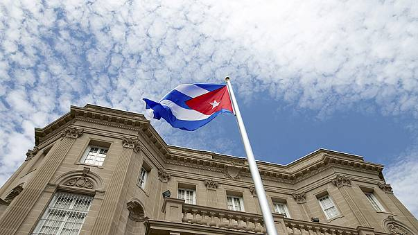 Cuban flag flies over Washington embassy as countries officially restore ties