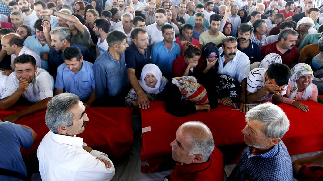 Disbelief and determination at funeral for Suruc suicide-bomb victims