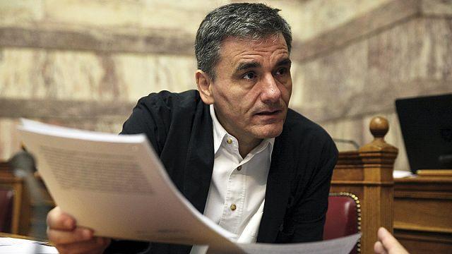 """Греческие законодатели обсуждают пакет реформ, предложенных """"тройкой"""""""