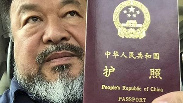 Artist Ai Weiwei's confiscated passport returned after 4 years